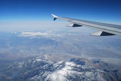 Flying over the Rockies. Stock Images