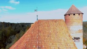 Flying over roof. Turaida castle on springtime, Sigulda, Latvia. Flying around Ruins of Turaida castle on springtime, Sigulda, Latvia,Turaidas pils stock video footage