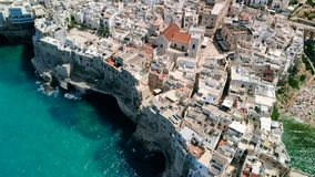 Free Flying Over Rooftops Of Italian City Of Polignano A Mare , Apulia Royalty Free Stock Images - 153563239