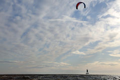 Flying over the sea on a paraglider. Flying over the sea on a paraglider Royalty Free Stock Image