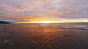 Flying over Sea, Time Lapse Sunset and Clouds. Russian, Kamchatka. Aerial camera shot. stock footage