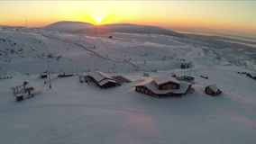 Flying over the ski centre area at sunset stock video footage