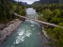 Flying over Skykomish River. A view over the Skykomish river and a bridge in northwestern Washington state royalty free stock photography