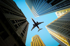 Flying over skyscrapers. Airplane is in the sky flying over the tall high-rise buildings in the financial district Stock Photos