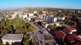 Flying over a small town in Romania stock footage