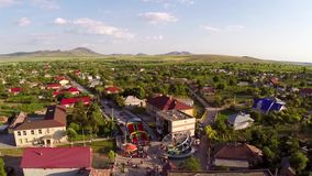 Flying over a small village in celebration day stock video footage