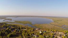 Flying over a small village in Danube Delta stock footage