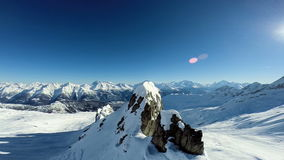Flying over snow covered mountains aerial view winter landscape stock footage