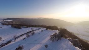 Flying over snow-covered winter landscape stock video footage