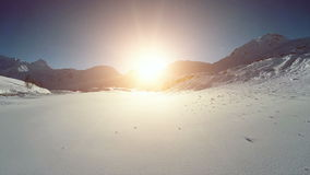 Flying over snowcapped mountain landscape winter panorama. Video of flying over snowcapped mountain landscape winter panorama stock footage