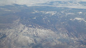Flying over snowy mountain tops stock video footage