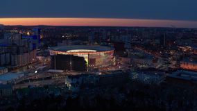 Russia Ekaterinburg, Repin street, 5, the Stadium `arena Yekaterinburg` 2019.04.07. Flying over the stadium in the city in winter during football championship stock video footage