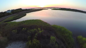 Flying over still waters at sunset. Video of flying over still waters at sunset stock video