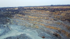 Flying over a stone quarry. The flight of a quadrocopter in the spring over a stone quarry. Aero survey stock footage