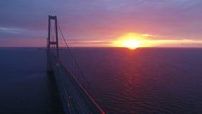 Flying over Storebaelt bridge on sea stock video