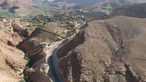Flying over a Street near Dadès Gorges in Morocco with Drone from above (Aerial) stock footage
