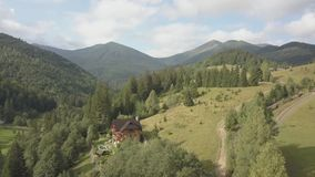 Aerial top view other summer carpathian mountains near by Dzembronya village, Ukraine. Flying over summer carpathian village Dzembronya, Ukraine stock video