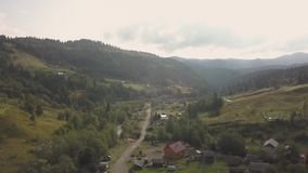 Aerial top view other summer carpathian mountains near by Dzembronya village, Ukraine. Flying over summer carpathian village Dzembronya, Ukraine stock video footage