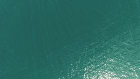 Flying over the surface of the Lake Garda water surrounded by mountains, Italy. video shooting with drone. Panorama of the gorgeous Lake Garda surrounded by stock footage