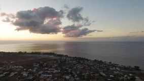 Flying over the Tamarin in Mauritius. Evening landscape with mountain in Background stock video