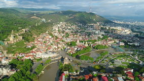 Flying over Tbilisi city center. Tbilisi is the capital and the largest city of Georgia. stock video footage