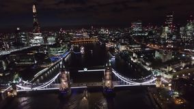 Flying over tower bridge at night, London England stock video footage