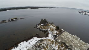 Flying over the township on coast in winter stock video footage