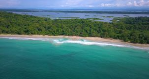 Aerial drone view of a Tropical caribbean beach in Bocas del Toro, Panama. Flying over a tropical caribbean beach in Bocas del Toro, Panama stock video