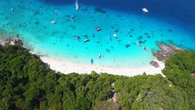 Flying Over Tropical Sandy Beach and Blue Clear Water with Boats. Aerial HD Slowmotion. Similan, Thailand. stock footage
