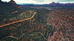Flying over Verde Valley. Aerial footage of Verde Valley and Sedona in Arizona from Schnebly Hill on an overcast day stock video