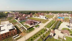 Flying over the village. Aerial Shot. Royalty Free Stock Image