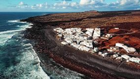 Flying over volcanic Lake El Golfo, Lanzarote, Canary Islands, Spain stock video footage
