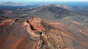 Flying over volcano near Timanfaya National Park, Lanzarote, Canary islands stock footage