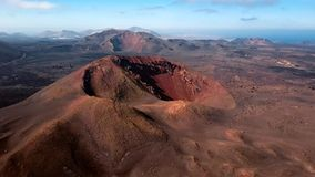 Flying over volcano near Timanfaya National Park, Lanzarote, Canary islands stock video footage