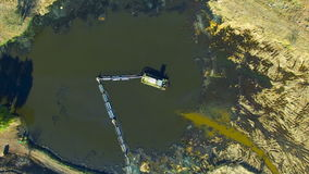 Flying over water treatment plants. Sediment with rusty water. aerial survey stock video footage