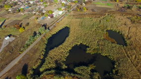Flying over water treatment plants. Sediment with rusty water. aerial survey stock footage