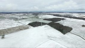 Flying over the windmill in Lithuania. Late winter season in background stock footage