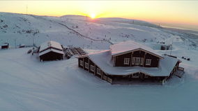 Flying over the winter ski centre at sunset stock video footage