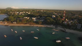 Flying over yachts and houses on Mauritius coast. Aerial shot of Mauritius Island with houses, many yachts and boats along the coastline stock video footage