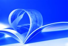 Flying pages on blue stock photo
