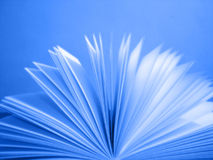 Flying paper. With blue background Royalty Free Stock Photography