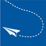 Flying paper airplane on blue