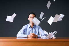 Flying paper and businessman. In office Royalty Free Stock Photo