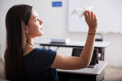 Flying paper planes in detention Royalty Free Stock Image