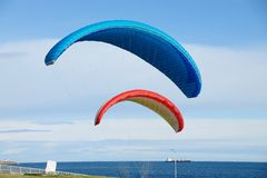 Flying parachute in the sky Royalty Free Stock Photos