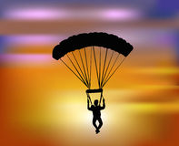 Flying with the parachute in the sunset. Vector illustration of man flying with the parachute in the sunset Stock Photo