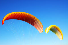 Flying parachutes Stock Photography