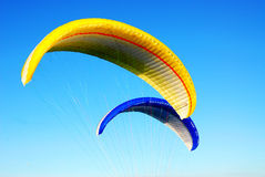 Flying parachutes Stock Photos