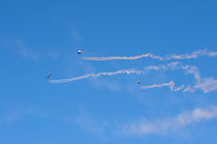 Flying parachutists in the sky at an air show. Editorial. Flying parachutists in the sky at an air show Royalty Free Stock Photography