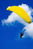 Flying with the paraglide. Couple flying with the paraglide Stock Photography